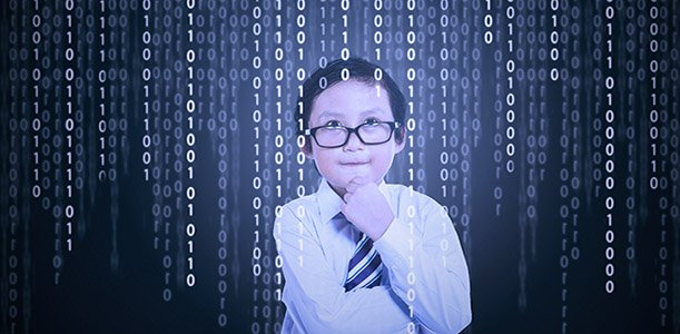 Portrait of little boy in front of a computer screen with binary code on it